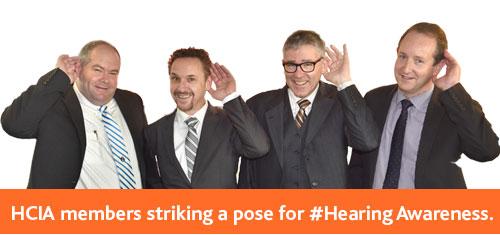 HCIA members striking a pose for #HearingAwareness
